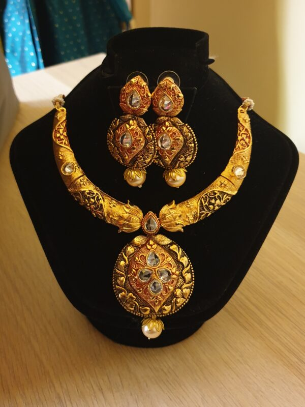 Necklace with ornament