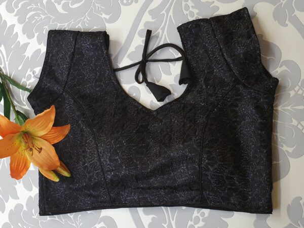Blouse with glitter and embroidery