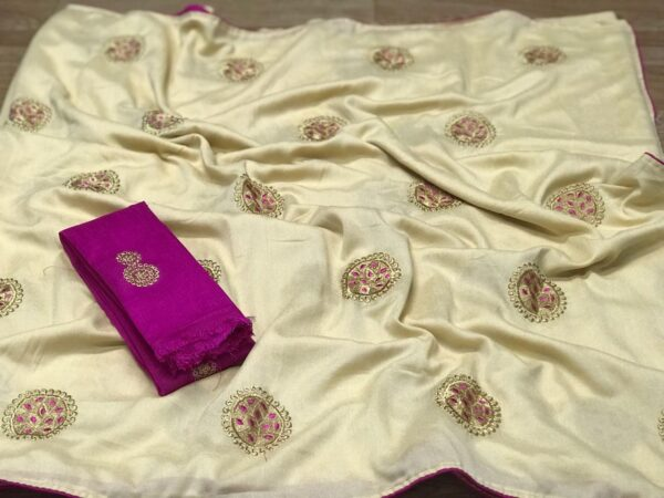 Embroidered saree with contrast blouse